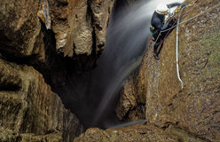 Speleologist At Work. Speleologist Inside Deep Waterfall Entrance Shaft At Mayei Cave In Ecuadorian Amazonia Blurred Motion Stock Photos
