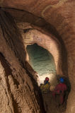 Speleologists in cave. Cave with speleologist exploring an uderground lake Royalty Free Stock Photography