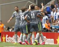Spelers die van Real Madrid doel vieren stock foto's