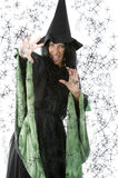 The spell. Pretty woman in witch dress making magic spell with hand Royalty Free Stock Photography
