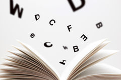 Spell book. With flying numbers Stock Photo