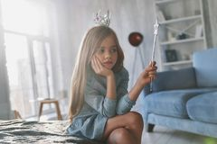 Spell does not work. Disappointed little girl playing with a mag stock photo