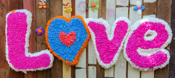 Spell the word LOVE made ​​from candle drippings colorful Stock Images