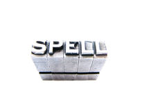 Spell written in vintage letterpress blocks Royalty Free Stock Image
