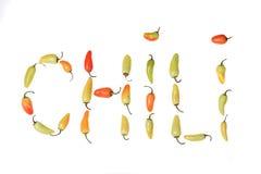 Spelline vermelho para fora C h das pimentas amarelas e verdes mim l i. Foto de Stock