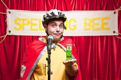 Spelling Bee Contestant. A grown man pretending to be a young boy competeing in a spelling bee Stock Images