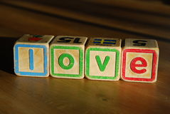 Spelling love with toy blocks Royalty Free Stock Images