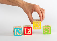 Spelling the Word News with Coloful Blocks Stock Images