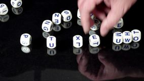 Spelling words with dice stock video footage
