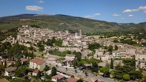 Spello, one of the most beautiful small town in Italy. Drone aerial view of the village stock video footage