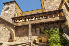 Spello (Umbria). Spello (Perugia, Umbria, Italy) - Courtyard of an ancient palace with gallery royalty free stock image