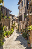 Spello (Umbria). Spello (Perugia, Umbria, Italy) - Typical alley with potted plants and flowers stock image