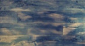spelrum med lampa Abstrakt wood lantlig tonad texturtappning Arkivfoto