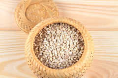 Spelt. In the basket on the wood Royalty Free Stock Photos