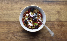 Spelt with beetroot, blackberries and sour cream. Stock Images