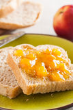 Spelt bread slices on a dish with peach marmalade close-up Stock Image