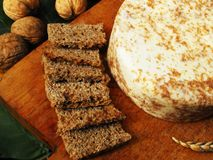 Spelt bread with special cheese and nuts. Spelt bread with special cheese with nuts on wooden board. Arrangement with food and all grain. Bread with spelt flour stock photos