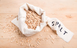 Spelt flakes in a cream fabric bag with a stencilled label Royalty Free Stock Photography