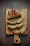 Spelt flour bread, sliced on a cutting board for breakfast Royalty Free Stock Photos