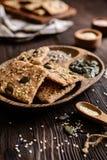 Spelt flour crackers with pumpkin, sunflower, sesame, flax and hemp seeds stock photos