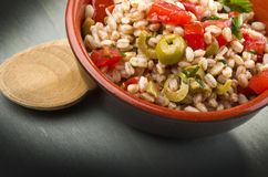 Spelt soup. With vegetable and green olives Royalty Free Stock Images