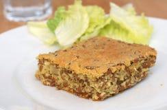 Spelt (Triticum spelta) cake. Healthy vegetarian lunch: spelt (Triticum spelta) cake with spelt grains served with green lettuce Stock Images