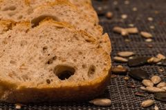 Spelta bread. Slices of spelta bread with the cereals grains. Macro photo Stock Images