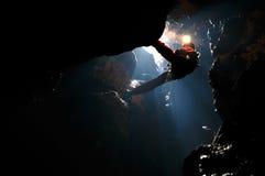 Spelunker rapelling in a sinkhole. Spelunker rapelling on a rope in a sinkhole Royalty Free Stock Photos