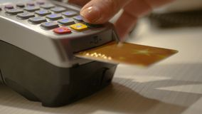Spend electronic money through the card and the bank terminal in the store. HD. Spend electronic money through the card and the bank terminal in the store. Foto royalty free stock photography