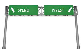 Spend or Invest. Highway sign displaying spend or invest financial dilemma Stock Photos