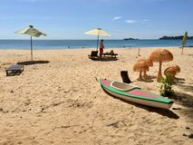 Spend leisure time on the beach. Hot sunny day, daylight, sand, beach, lone, two, three, one, single, kayak, boat, ship, daylight, sky, skyline, five mushrooms royalty free stock image