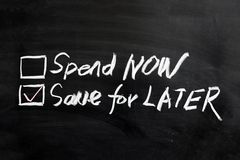 Spend now or save for later Royalty Free Stock Images