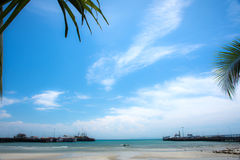 Spend the time on the beach,Sea, sky and trees on the beach,Blue sky and sea. Beach in summer ,Beach on the wild island in Thailand Royalty Free Stock Photography