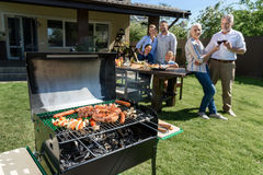 Spend time together while having barbecue with grill at yard royalty free stock photos