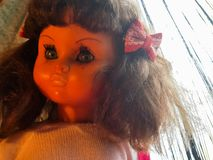 Doll with a melancholy look. They spend years and this doll seems to rejuvenate Stock Photos