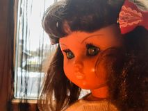Doll with a melancholy look. They spend years and this doll seems to rejuvenate Stock Photography