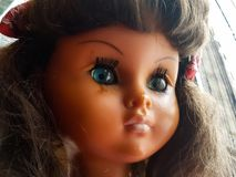 Doll with a melancholy look. They spend years and this doll seems to rejuvenate Royalty Free Stock Image