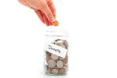 Spenden Sie Geld Stockbild