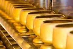 Spenden Sie Glasgold Stockbild