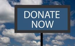 Spenden Sie jetzt Zeichen Stockbild
