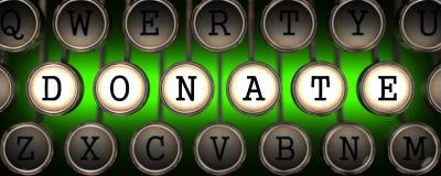 Spenden Sie Konzept auf den Schlüsseln der alten Schreibmaschine. Lizenzfreies Stockfoto