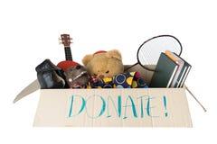 Spendenkasten voll mit Material für Kind Lizenzfreies Stockfoto