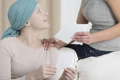 Spending day with cancer patient stock image