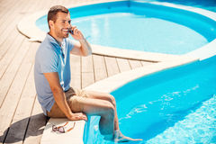 Spending great time poolside. stock image
