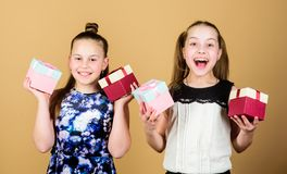 Spending great time together. Boxing day. Christmas shopping. Happy birthday. Holiday celebration. Small girls with. Present box. Surprise. Family sisterhood stock photos