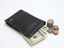Spending money. Black leather wallet with usd banknotes and small change royalty free stock photos