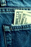 Spending Money 2. Fifteen American dollars in the pocket of a pair of blue jeans Royalty Free Stock Photos