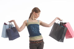 Spending money. A girl with shopping bags Stock Images