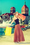 Fashionable woman walking with shopping bags Royalty Free Stock Photography