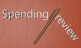 Spending review. Hatchet cutting between words Spending and review Stock Image